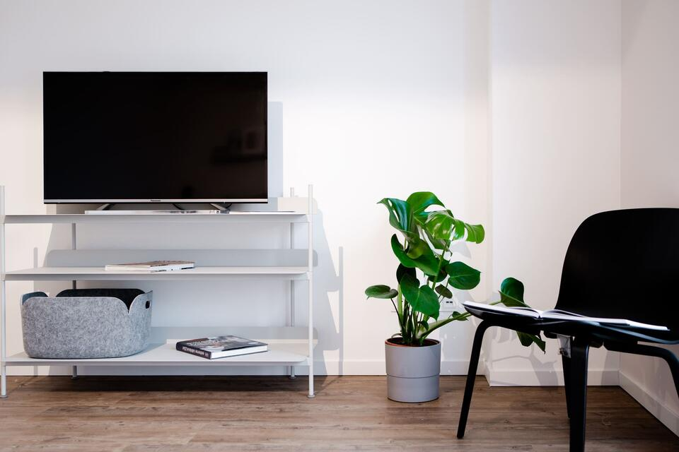 TV stands with black chair